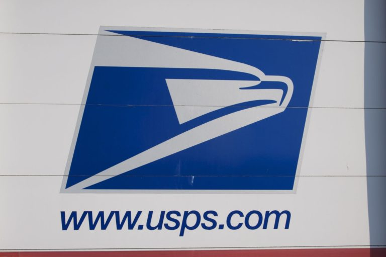 Postal Service halts some changes amid outcry, lawsuits