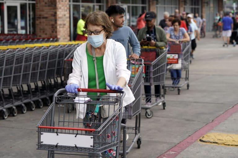 As daily virus deaths spike, Texas reopens door for business